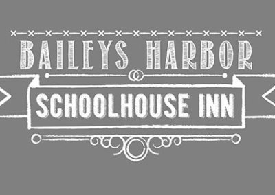 Baileys Harbor Schoolhouse Inn logo